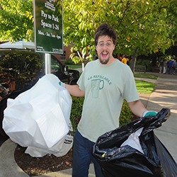 Zero Waste employee holding two bags full of recyclable materials