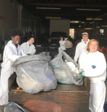 Sustainability ambassadors sort trash as part of a waste audit.