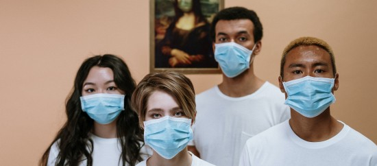 Young people wearing medical masks.