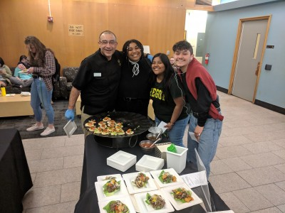 Chef poses with students tasting his low carbon footprint bite