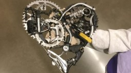 Heart-shaped piece made up of bike gears and other parts.