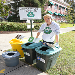 Zero Waste employee at an event materials station